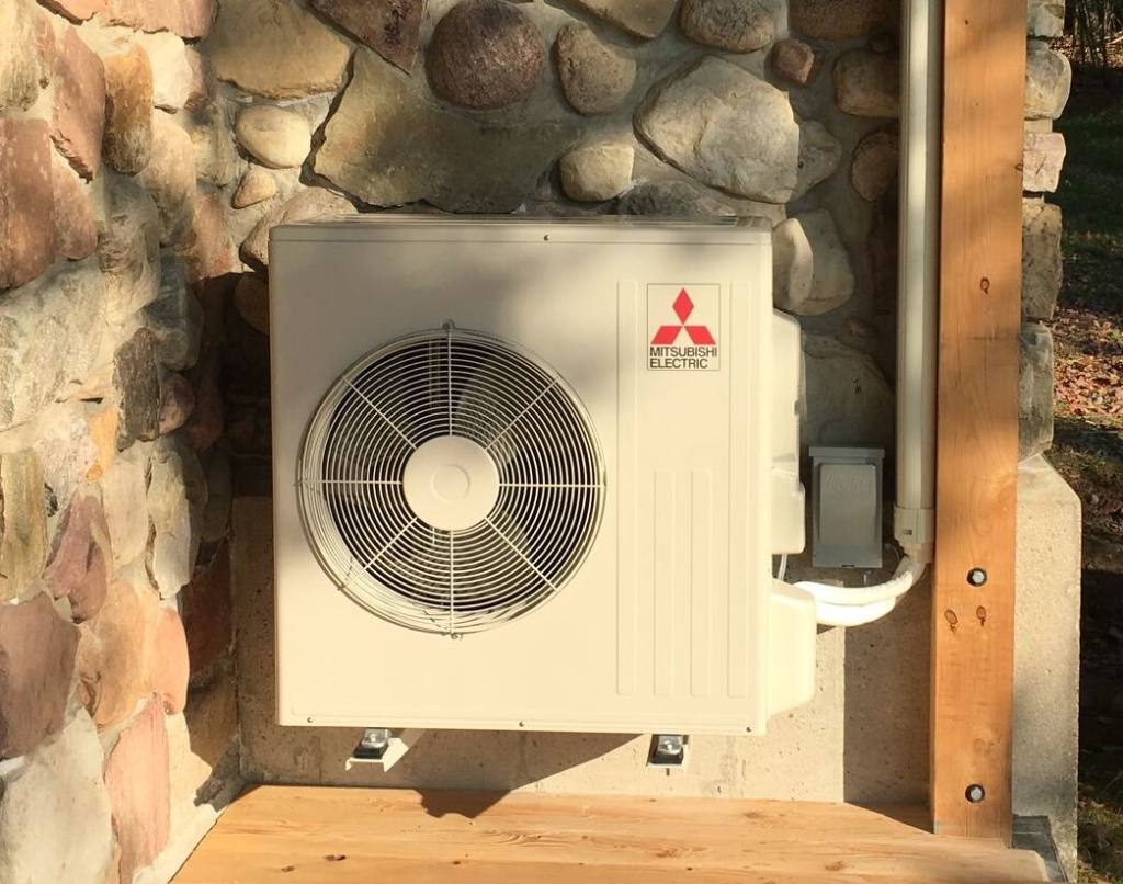 A picture of the outdoor unit in an air source heat pump